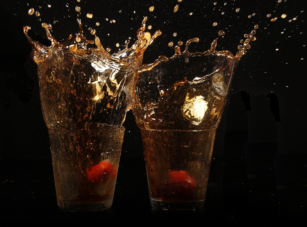 2 glasses with soda splashing out
