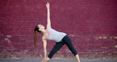 Beginner Stretch in Front of Red Brick Wall
